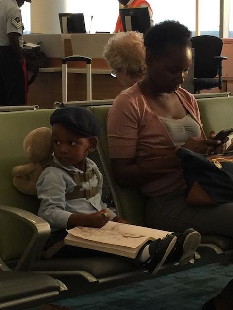 This little guy was too cute for words - doing his coloring in at Nassau airport