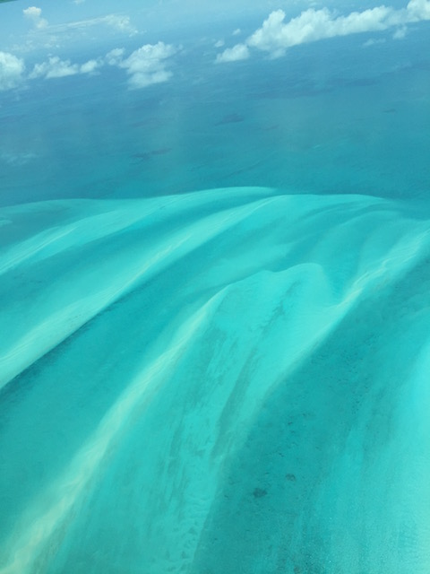 The waters of the Bahamas still charm when viewed from the plane.....