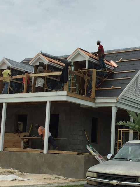 Flora's Cottage roof being shingled