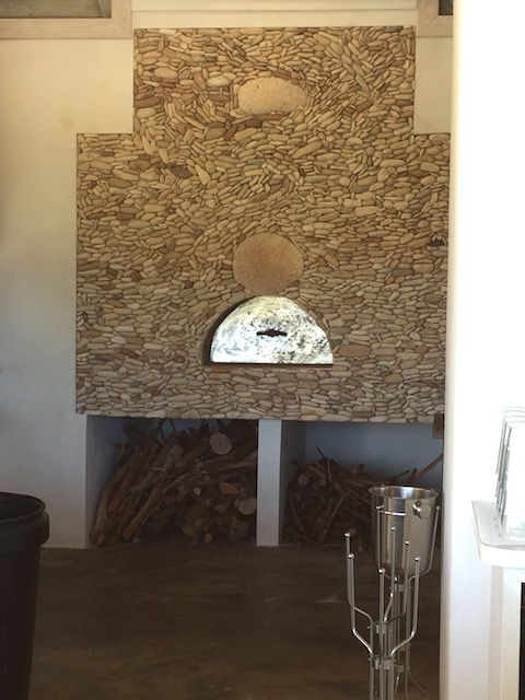 The pizza oven with brilliant stonework but the artist Celes - well known and revered on the island for his beautiful work.....
