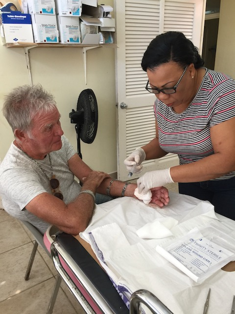 Nurse Debbie Deal at the Levy Clinic stitching Bob up