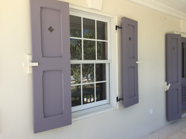 The shutters at Flora's House - notice the peep hole to look out through when the shutters are closed during a hurricane.