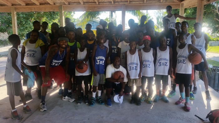 Coach Tiny Johnson of Harbour Island with the young competitors from his club