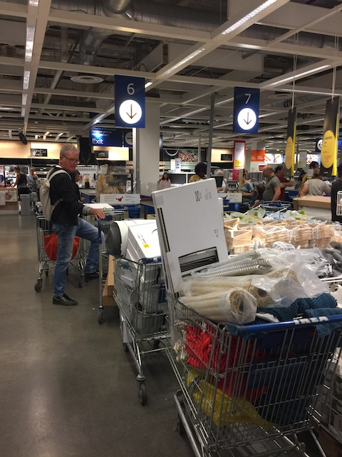 Bob waiting at the checkout in Ikea with 5 trolleys of goods ! Do you think he looks like a happy birthday boy ??