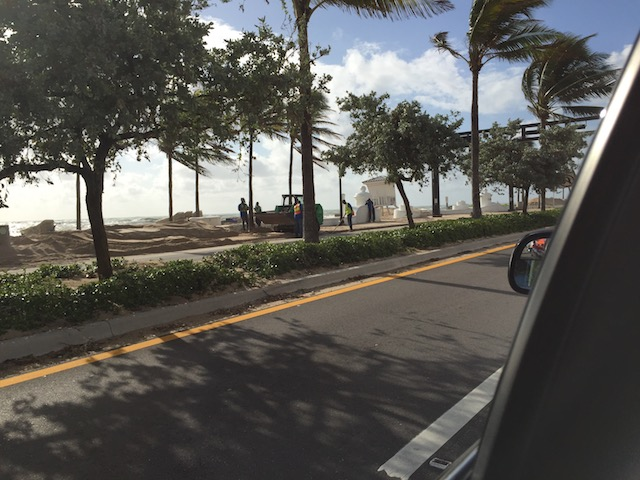 Big piles of sand moved off the road in Ft Lauderdale