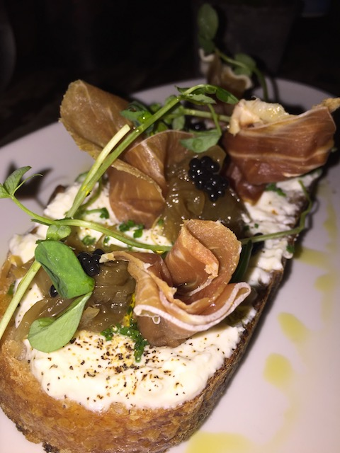 This is so good - truffled ricotta on toast with prosciutto at One Door East
