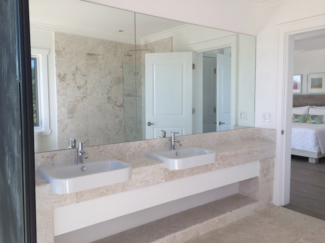 I used corolina tile on the floors and in all the bathrooms - a) because I love a sense of continuity and b) because this natural stone is perfect for an island setting