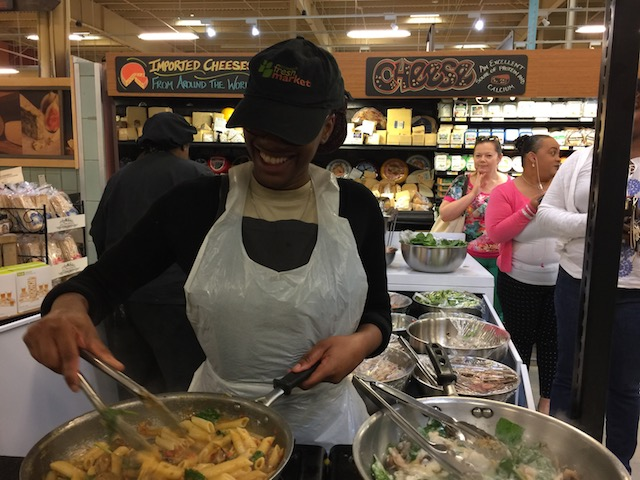 The smiling cook in FreshMarket with 2 pans on the go .....