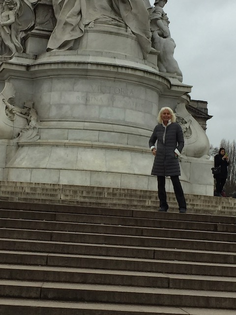 This is the statue of Queen Victoria outside Buckingham Palace - but you can't see her - only me !!