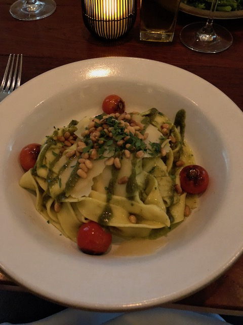Beautiful pesto pappardelle with pine nuts, roasted tomatoes and deliciousness !
