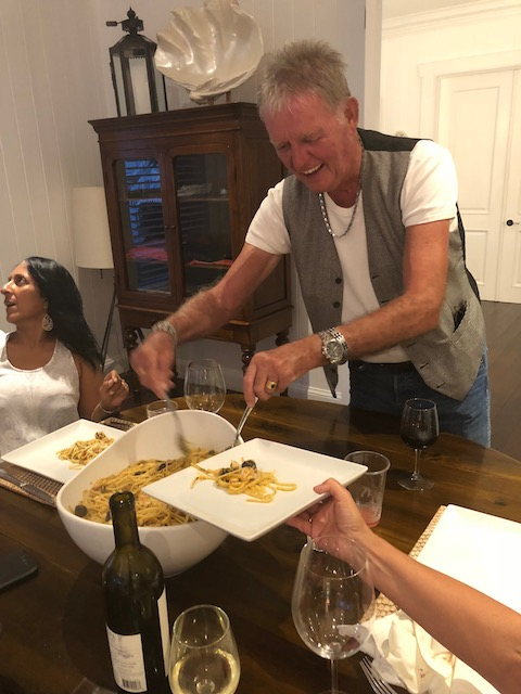 Bob serving out seafood pasta with the amazing superwoman - known as Michele Johnson in the background.