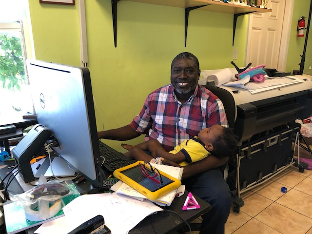 Dion from Island Design on Cupid's Cay multitasking while drawing up some design work for the party ....
