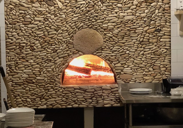 Now that's what you call a wood burning pizza oven - at La Bougainvillea