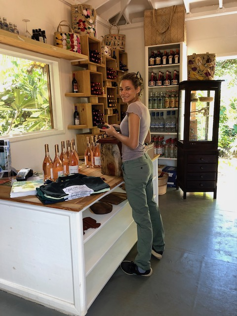 The lovely Rea Bethel stocking the shelves with a great rose wine....