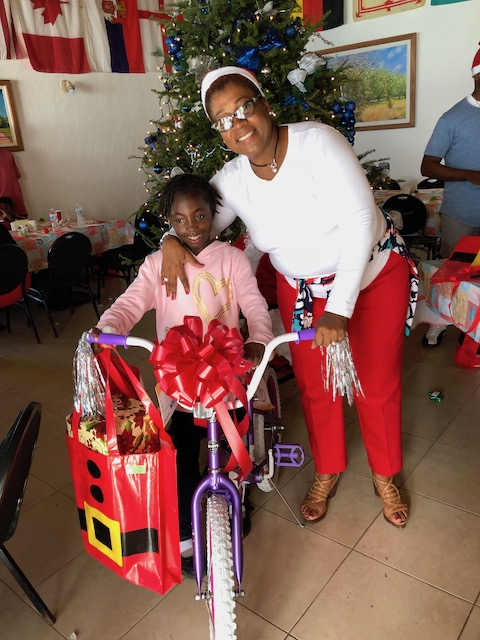 Kayla with Agatha Bethel and her new bike !