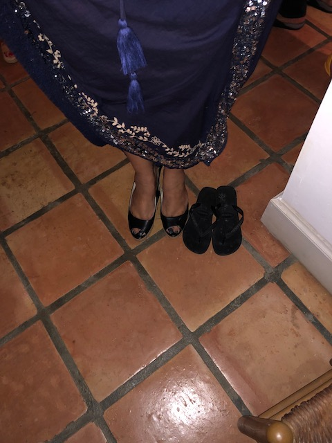 Angelika was the most sensible person out on new Year's Eve - party shoes on - walking from house to house shoes waiting !